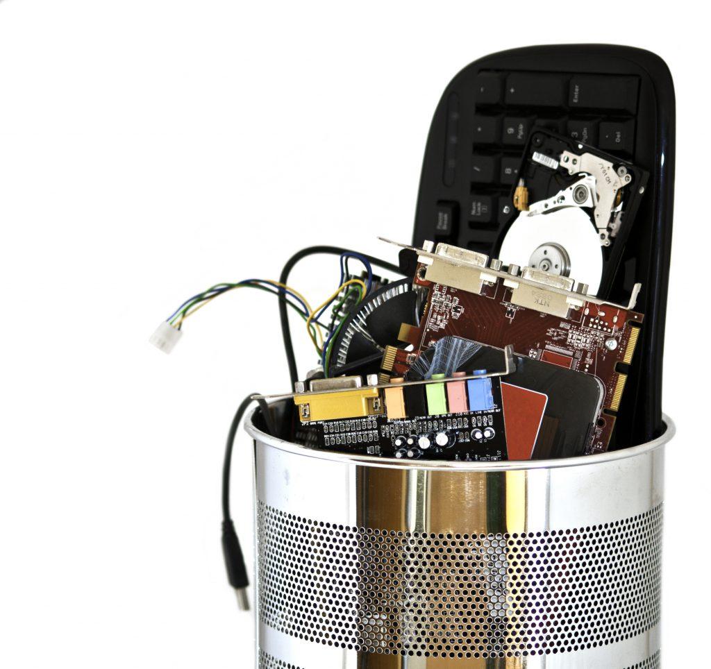 metal trash can containing computer waste fJZTosAO 1 copia